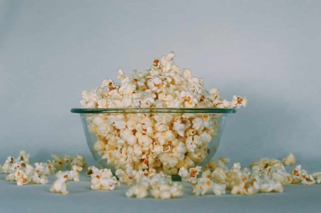 Picture of puff popcorn in a clear glass bowl.