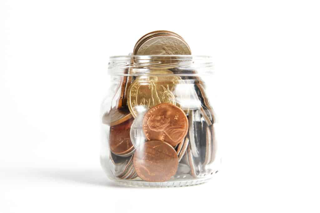 how to save and budget in 2019 in post image 3. Image of pennies in bar.